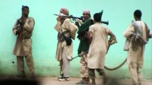 A still from a video shows armed Islamists patrolling in the streets of Gao