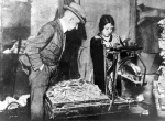 Mark notes are weighed by a woman in 1923. By then the currency was worth little more than the paper it was printed on.