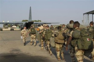 French troops prepare to board a transport plane in N'Djamena, Chad
