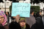 A protester holds a sign which says--'Today Chukri, who will it be tomorrow' outside the Tunisian Ministry of Interior in Tunis.