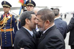 Egyptian President Mohamed Morsi embraces his Iranian counterpart Mahmoud Ahmadinejad-in Cairo