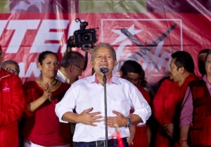 Salvador Sanchez Ceren celebrates election results