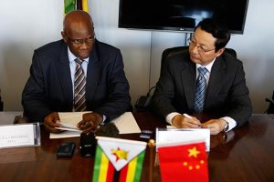 No cash handouts ... Patrick Chinamasa with China's ambassador to Zimbabwe Lin Lin