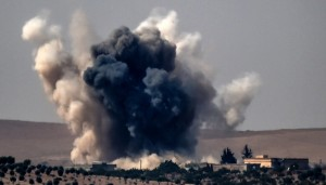 Smoke billows after Turkish airstrikes on the Syrian Turkish border village of Jarabulus during fighting against the Islamic State