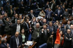 Brazilian senators celebrate after voting in Brasilia to permanently remove President Dilma Rousseff from office.