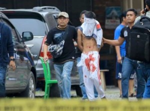 Plainclothes police detain a suspect after an attempted suicide