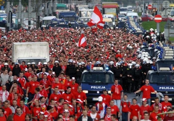 Polish soccer fans of the Widzew Lodz club escorted by police