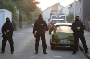 Special police officers secure a street near the house where a Syrian man lived before the explosion in Ansbach, southern Germany, on July 25.