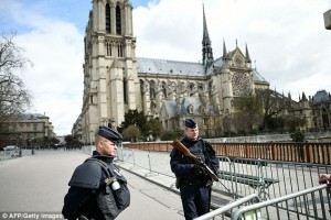 A car packed with gas cylinders was discovered close to the Notre-Dame cathedral in central Paris. Armed police are pictured guarding the building earlier this year.