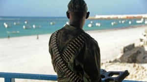 A Somali soldier looks at Lido beach on January 22 following an overnight attack on a beachfront restaurant in Mogadishu