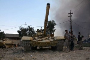 A tank of the Iraqi army is seen in the town of Qayyara