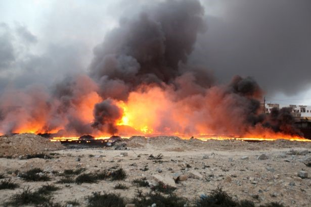 Fire rises from oil wells, set ablaze by ISIS militants before fleeing Qayyara.