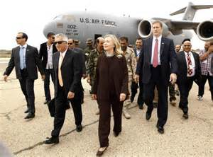 Hillary Clinton walks from her C-17 military transport upon her arrival in Tripoli Libya