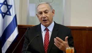 Israeli Prime Minister Benjamin Netanyahu gestures as he opens the weekly cabinet meeting at his Jerusalem office