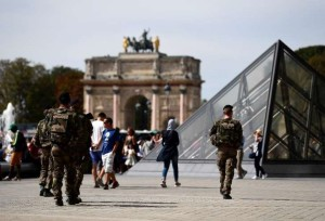 "Soldiers patrol around the Louvre Museum in Paris on September 10, 2016, as part of the ""operation sentinelle"" launched after January 2015 attacks."