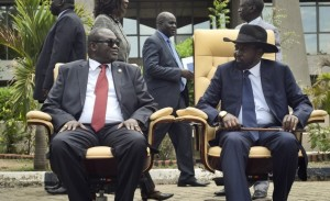 South Sudan's then-Vice President Riek Machar, left, exchanges a look with President Salva Kiir on April 29 as the two sit to be photographed after the first meeting of a new transitional coalition government in the capital, Juba.