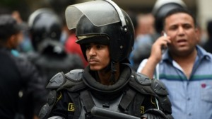 An Egyptian riot policeman stands guard during a Cairo protest
