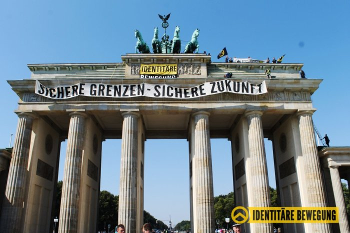 Brandenburg Gate banner stating 'secure borders – secure future'