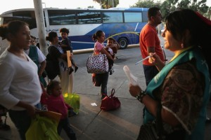 Central American immigrants who had been released from United States Border Patrol detention waited at the Greyhound bus station in McAllen, Texas
