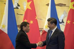 Duterte shakes hands with Xi Jinping