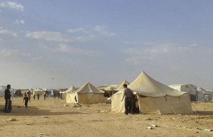 Syrians walk through the Ruqban refugee camp in Jordan's northeast border with Syria