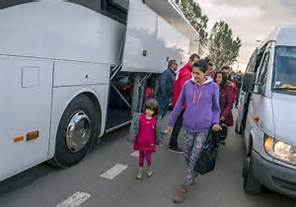 Boarding busses in Calais