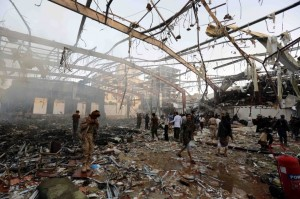 People inspect the aftermath of a Saudi-led coalition airstrike in Sanaa, Yemen, on Oct. 8, 2016