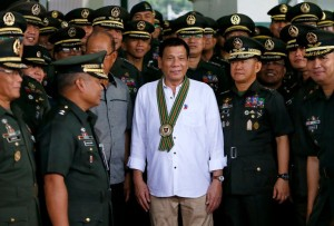 President Rodrigo Duterte of the Philippines, center, at army headquarters in Taguig.