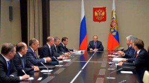 Russian President Vladimir Putin chairs a Security Council meeting in the Novo-Ogaryovo residence